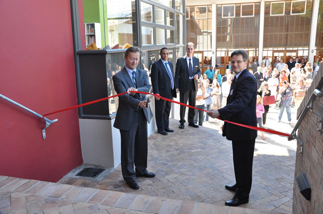Cutting the ribbon: From left to right – Ambassador of the Federal Republic of Germany, Dr. Horst Freitag; Dr Ivan Meyer, Provincial Minister of Cultural Affairs and Sport, Hermann Battenberg, Principal of the school and Wido Schnabel, Board Member.   Credit: Torsten Koehler